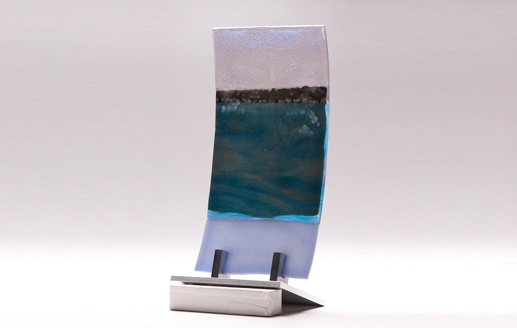 "Lake Superior Dawn I (curved) © 2010; Fused Glass; 6"" X 11"" X 3 ½"""