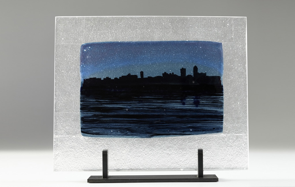 "Des Moines River Citiscape at Night (Black) © 2012; Fused Glass; 11 ¾"" X 15"" X 3 ½"";"
