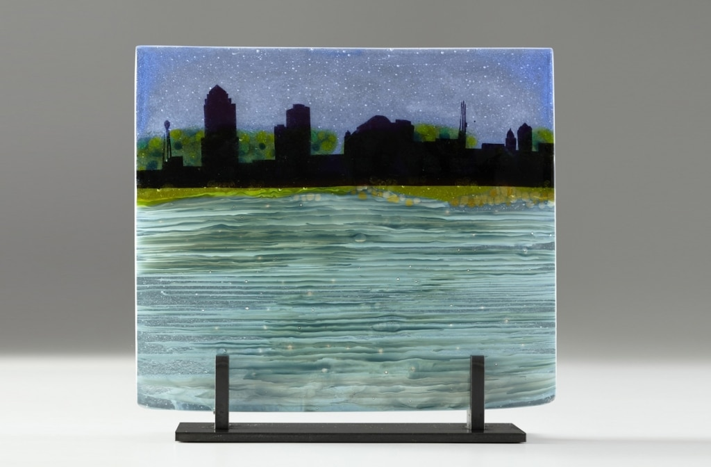 "Des Moines Citiscape from Gray's Lake © 2012; Fused Glass; 10 ¼ "" X 11 ½ "" X 3 ½"";"