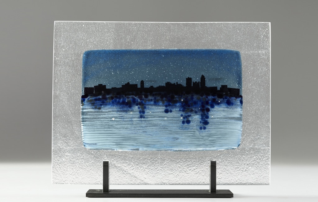 "Des Moines River Citiscape (White) © 2012; Fused Glass; 11"" X 14 ¼ "" X 3 ½"";"